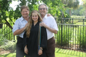 My grandpa and my dad posing with me on my high school graduation day in May 2011.