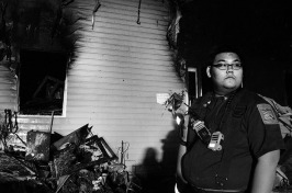 Volunteer firefighter Larry Wang, 23, of the Rockville Volunteer Fire Dept. assesses the scene of a fire that broke out a few hours prior and was extinguished by his firefighting comrades at Station 3. Responding to emergency situations can be thrilling, but these moments of reflection during the aftermath of a tragedy are what make volunteers like Wang keep doing their job. There is gratification in quelling a victim's feelings of fear and helping expedite the physical and emotional healing process.